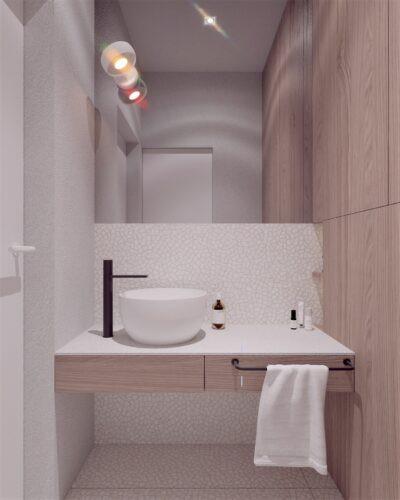 Klimatyczna łazienka z białym zlewem nablatowym