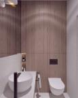 Mała łazienka z jasnymi płytkami i białą muszlą wiszącą