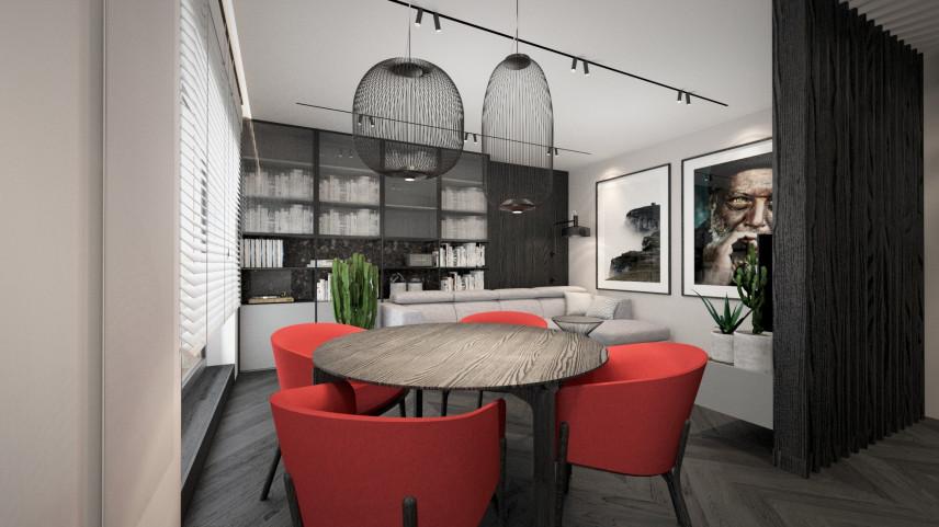 Jadalnia z czarną lampą wiszącą w stylu Art Deco i okrągłym stołem z czerwonymi krzesłami