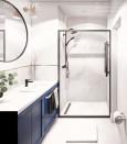 Łazienka z granatową szafką stojąca i lustrem w czarnej ramie