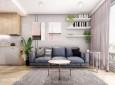 Salon w stylu glamour z szarą kanapą