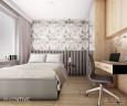 Sypialnia z jasną podłogą i drewnianymi meblami w zabudowie