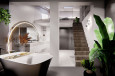 Łazienka z owalną wanną i schodami prowadzącymi do antresoli