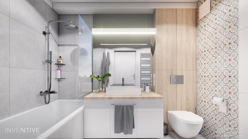 Łazienka z wzorzystymi płytkami na jednej ścianie