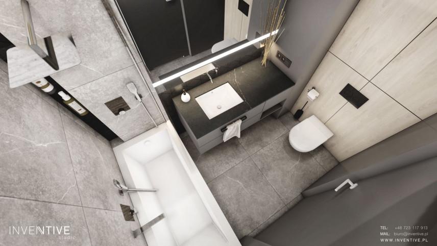 Łazienka z białym zlewem podblatowym
