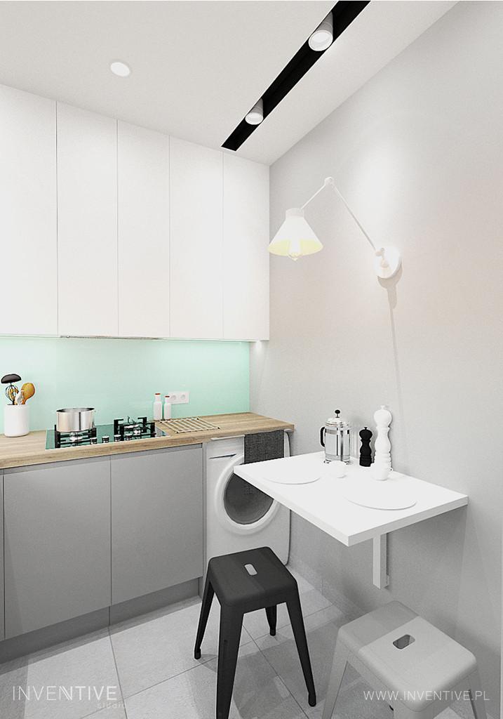 Kuchnia ze stołem przymontowanym do ściany