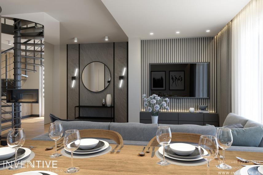 Aranżacja jadalni połączonej z salonem i telewizorem na ścianie