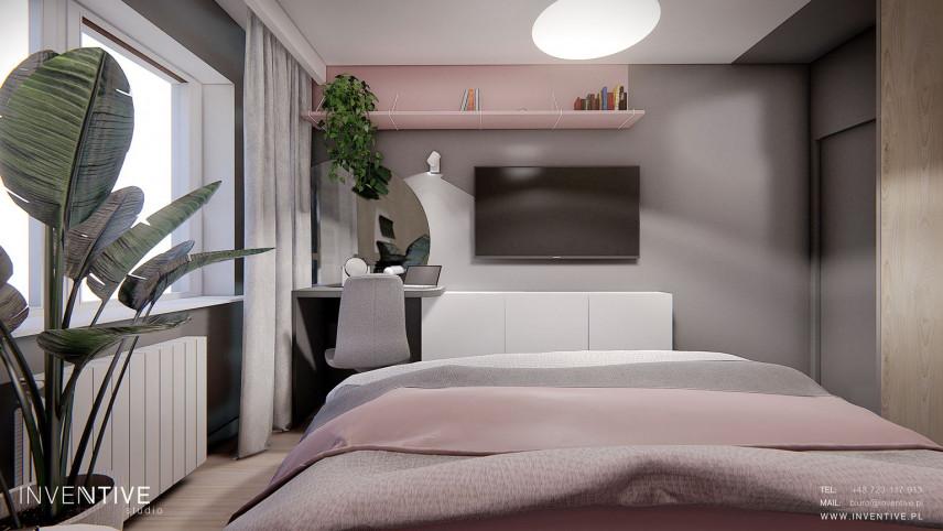 Sypialnia z telewizorem na ścianie i z różową półką