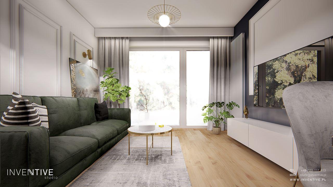 Projekt salonu z zieloną sofą i okrągłym stolikiem kawowym