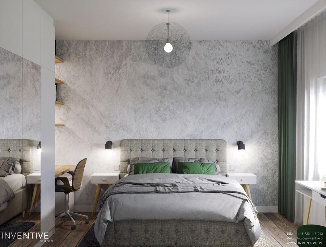 Sypialnia z tapetą na ścianie i z biurkiem