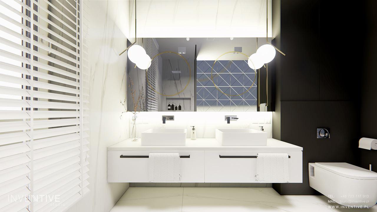 Aranżacja łazienki z czarno-białymi ścianami