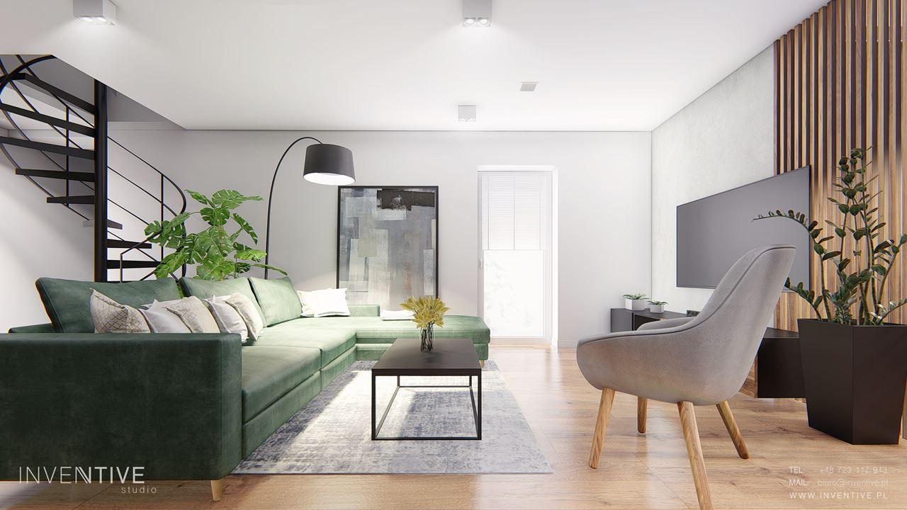 Salon z zielonym narożnikiem i szarym dywanem