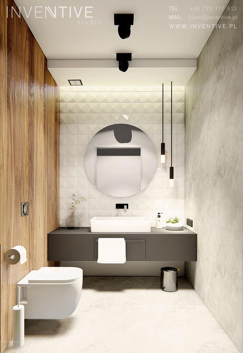 Łazienka z białą muszlą wiszącą i okrągłym lustrem