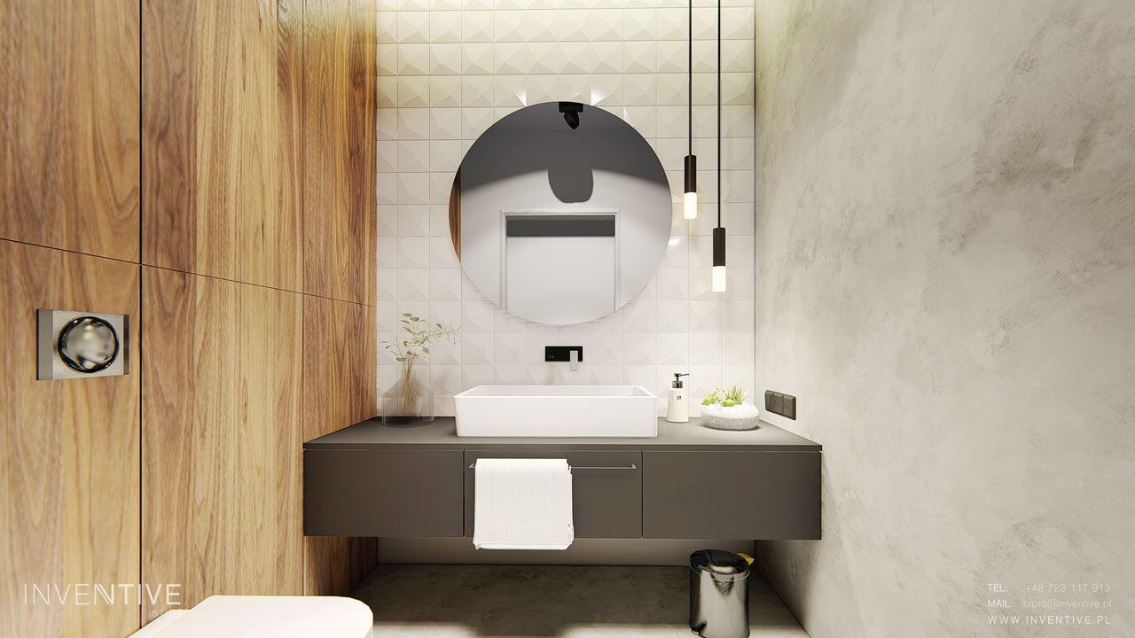 Mała łazienka pomalowana farbą dekoracyjną w kolorze szarym