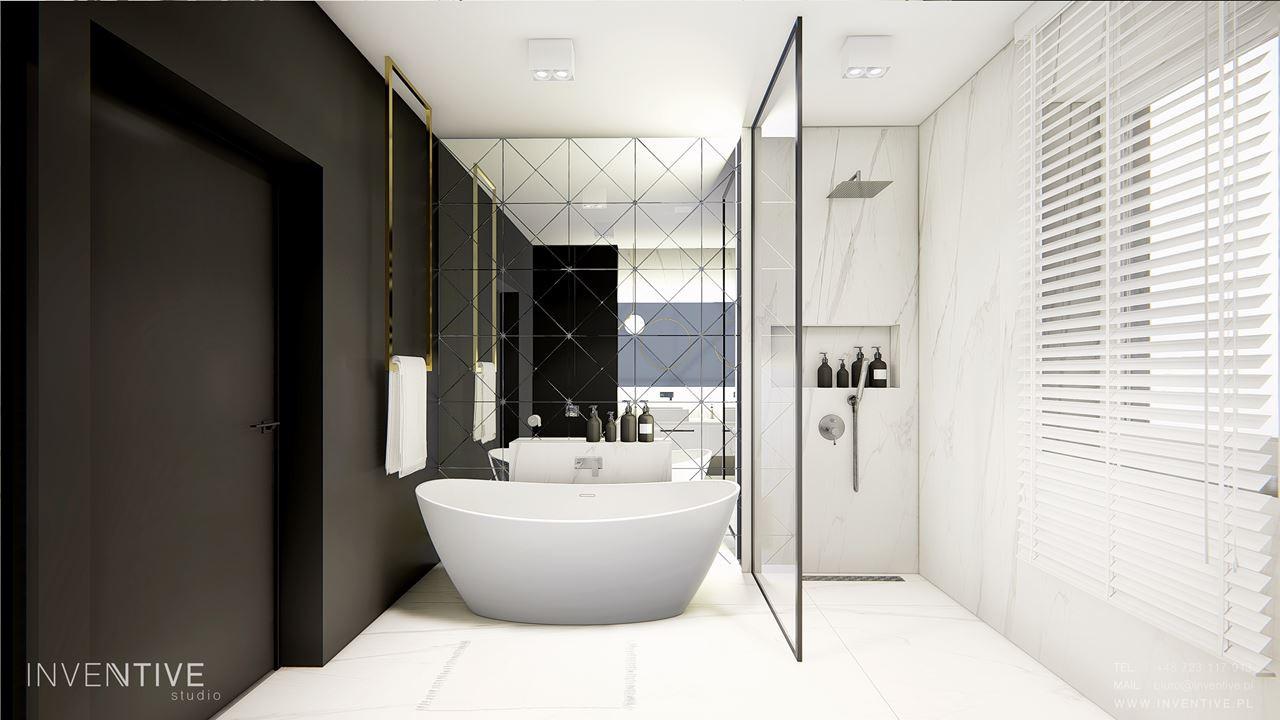 Łazienka z jedną ścianą czarną, a drugą z efektem lustra