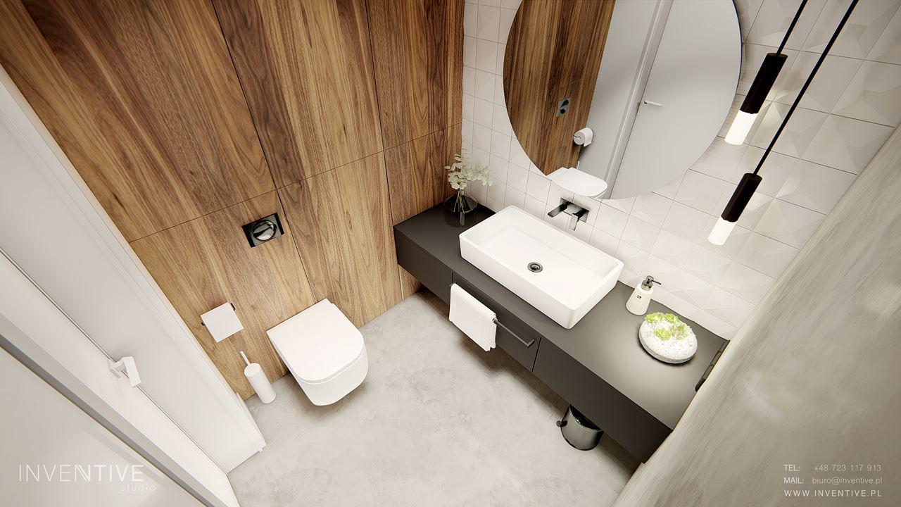 Łazienka z jasną podłogą i drewnianym motywem na ścianie