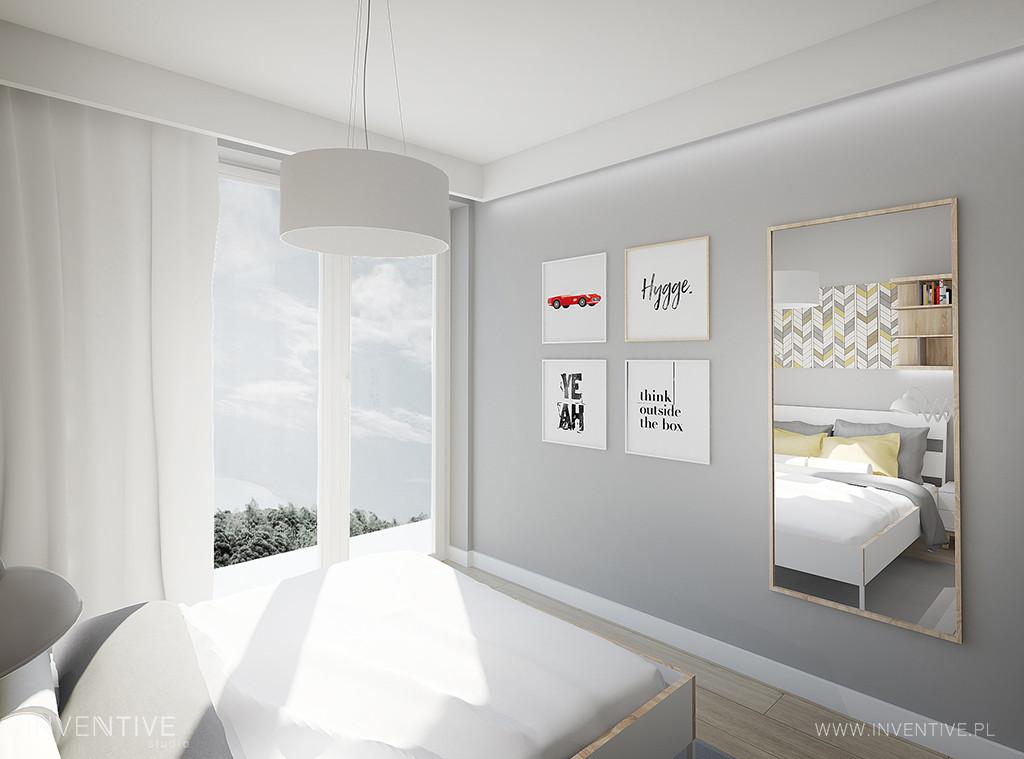 Sypialnia z modnymi plakatami na szarej ścianie