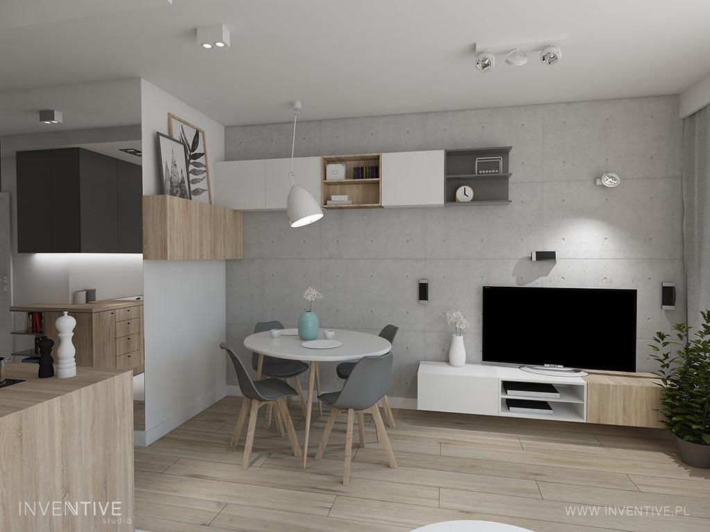 Salon z płytami betonu architektonicznego na ścianie