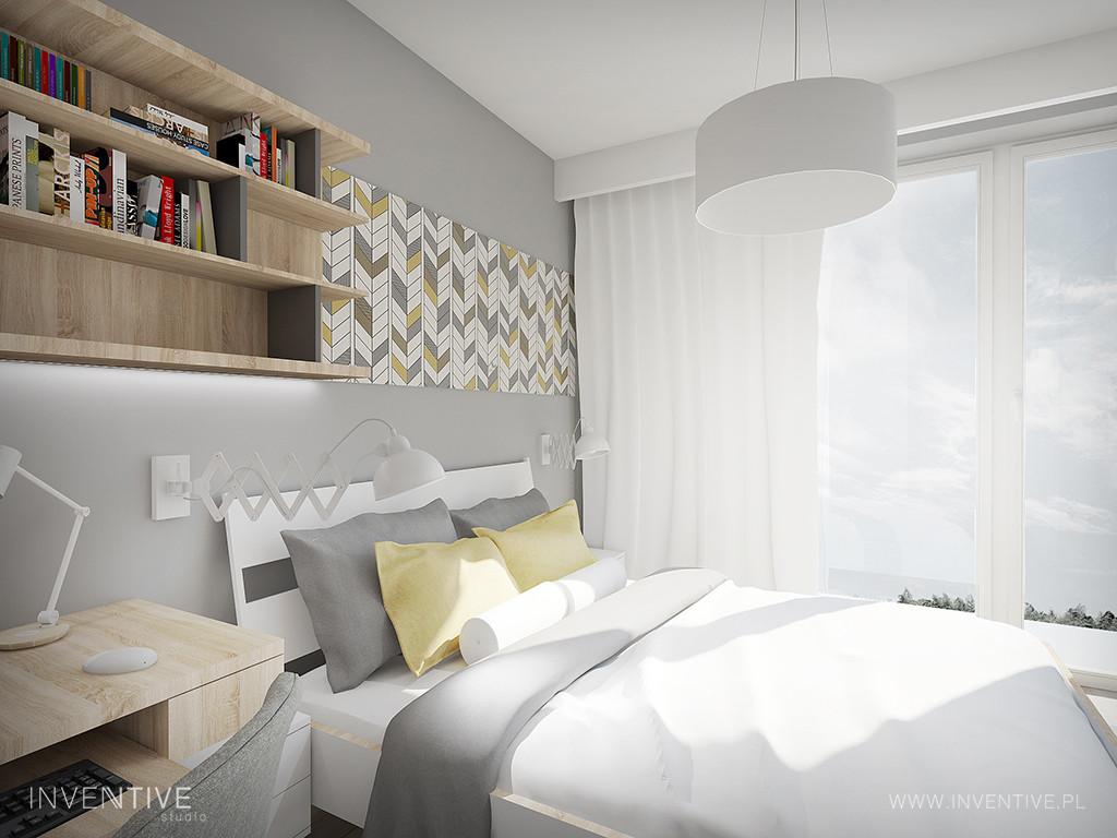 Sypialnia z drewnianym regałem wiszącym