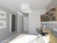 Sypialnia z meblami w zabudowie i z biurkiem