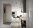 Przedpokój z białymi drzwiami w połysku i jasną podłogą