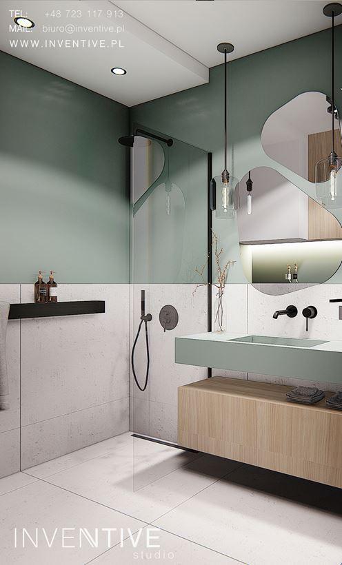 Projekt łazienki z prysznicem typu walk - in i z zielonymi ścianami