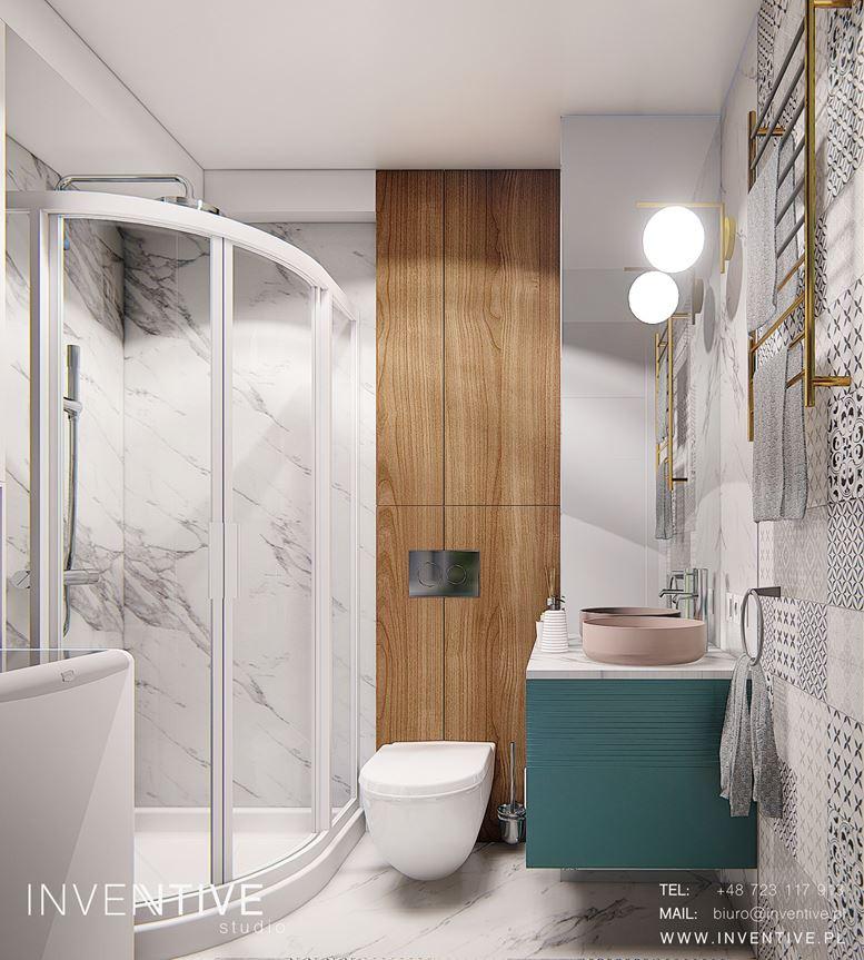 Aranżacja łazianki z narożną kabiną prysznicową