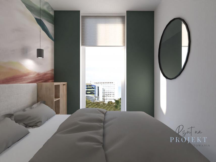 Sypialni z łóżkiem kontynentalnym i pejzażem na ścianie