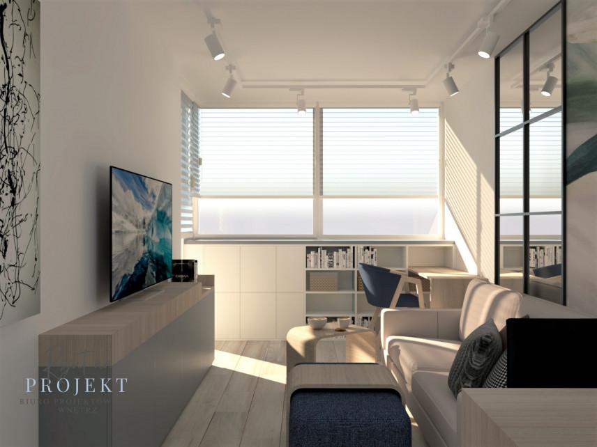 Salon z meblami w zabudowie, z telewizorem zamontowanym do ściany