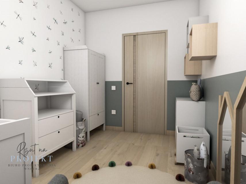Pokój dziecięcy w stonowanych kolorach z meblami