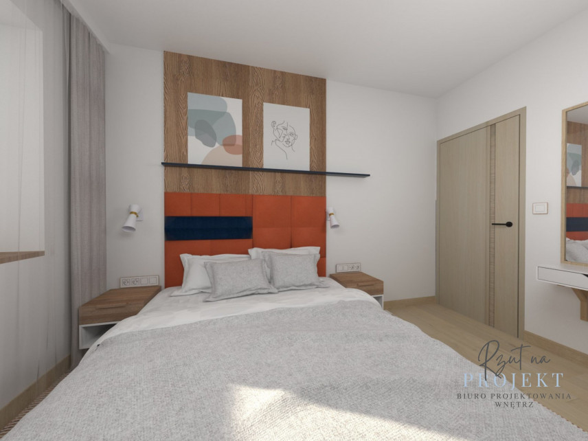 Sypialnia z łóżkiem kontynentalnym z pomarańczowym zagłówkiem