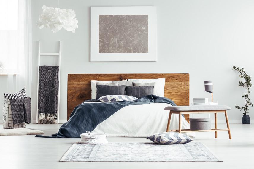 Szary obraz w sypialni w stylu skandynawskim