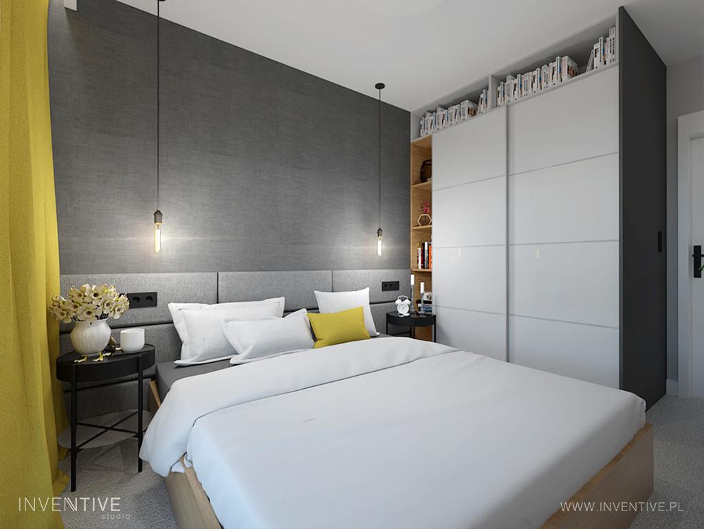 Sypialnia z szarymi ścianami i białą szafą w połysku