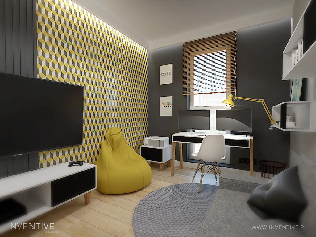 Pokój gościnny z tapetą na ścianie i biurkiem
