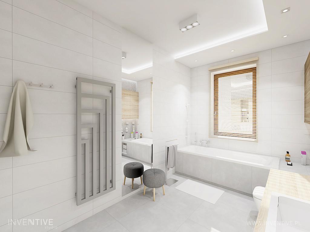 Duża przestrzenna łazienka z oknem nad wanną