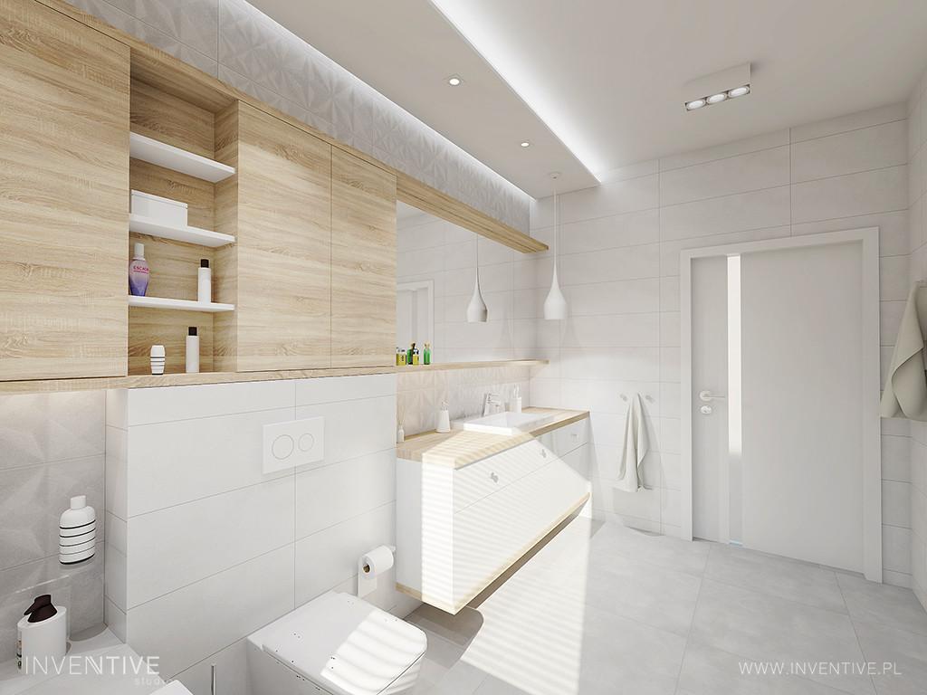 Przestrzenna łazienka z drewnianymi meblami w zabudowie
