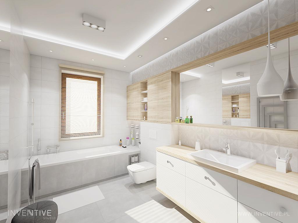 Aranżacja łazienki z szarymi płytkami na ścianie i na podłodze