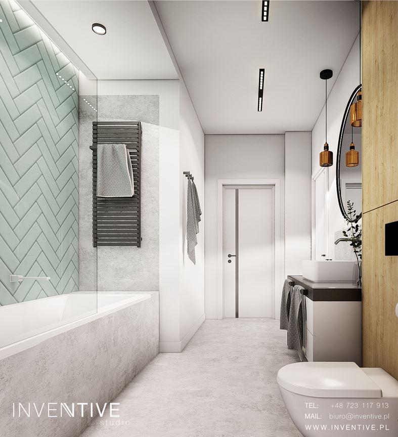 Projekt łazienki z wanną w szarej zabudowie