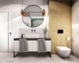 Łazienka z biała muszlą wiszącą i lustrem w czarnej ramie