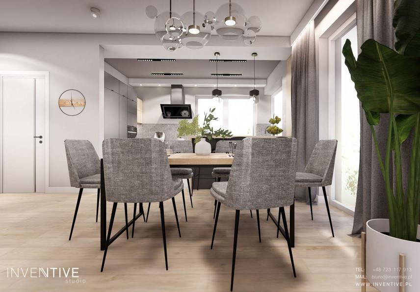 Jadalnia w stylu Art Deco z dużym, drewnianym stołem