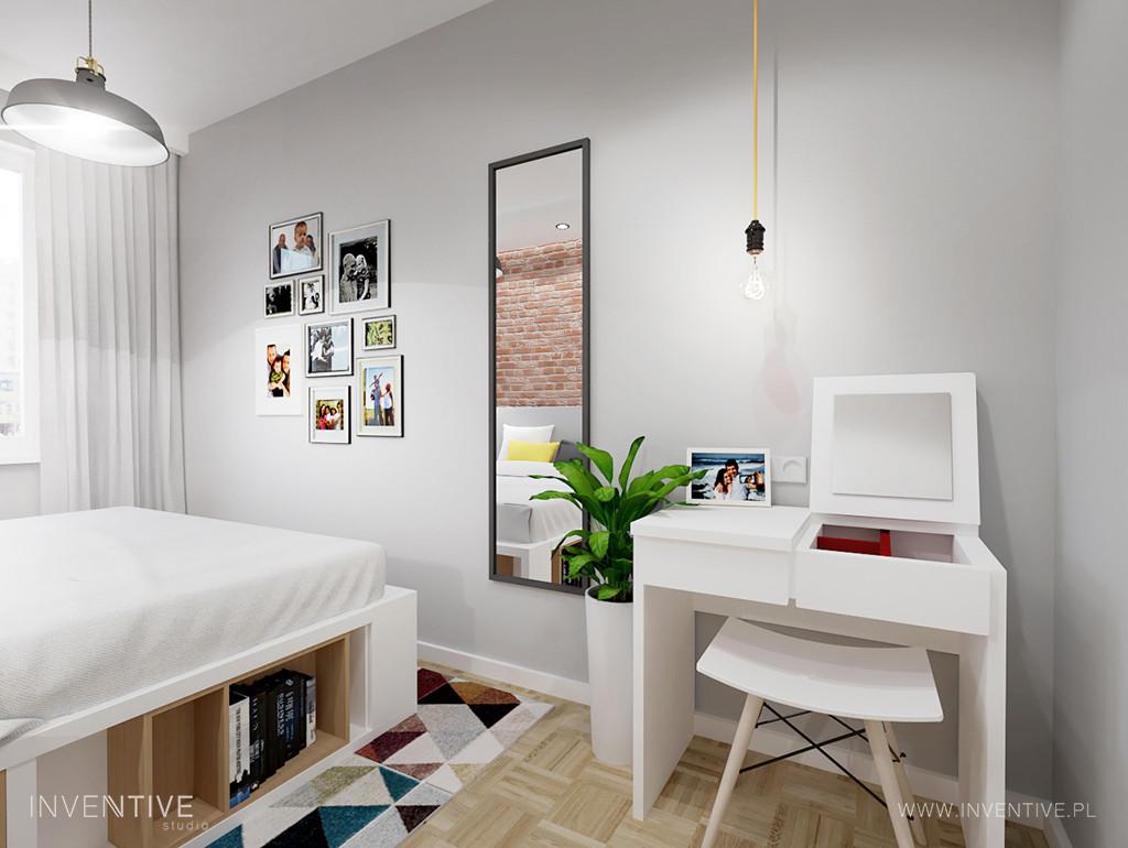 Mała sypialnia z drewnianym parkietem
