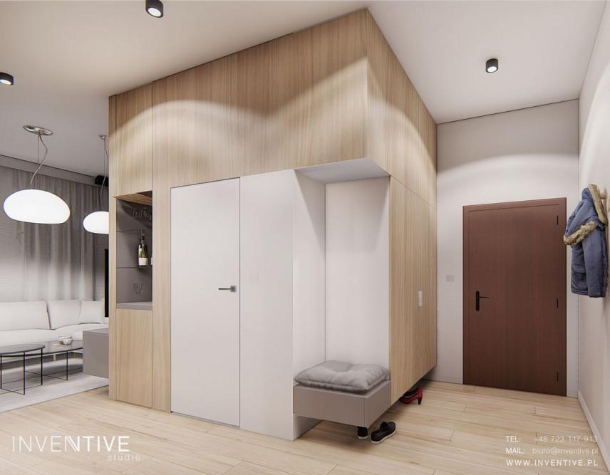 Przedpokój i korytarz z siedziskiem i szafą w zabudowie
