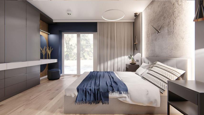 Aranżacja sypialni z łóżkiem kontynentalnym i farbą dekoracyjną na ścianie