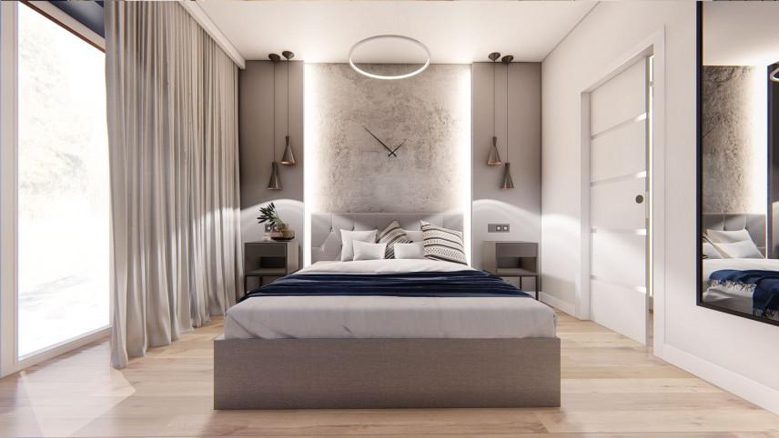 Sypialnia z podświetlaną ścianą nad łóżkiem kontynentalnym