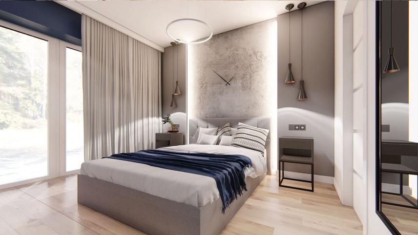 Sypialnia z łóżkiem kontynentalnym i lampami wiszącymi