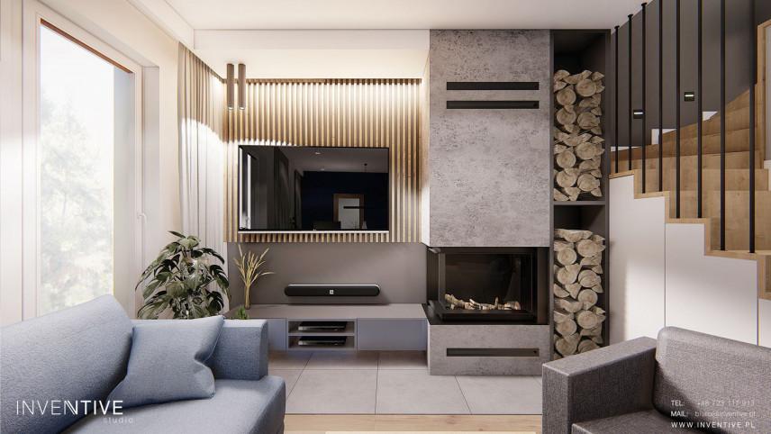 Salon z telewizorem zamontowanym na drewnianej ścianie