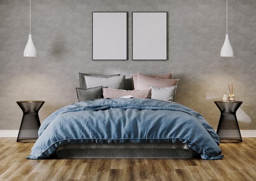 Nowoczesna sypialnia z szarą, betonową ścianą