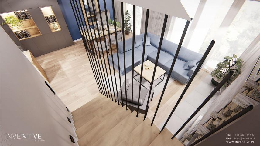 Aranżacja salonu w stylu nowoczesnym z drewnianymi schodami