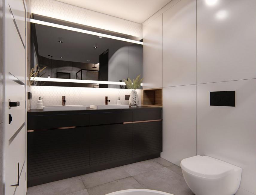 Łazienka z czarną szafką stojącą i zewami podblatowymi