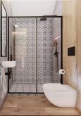 Aranżacja prysznica z wzorzystymi płytkami w kolorze czarno-białym